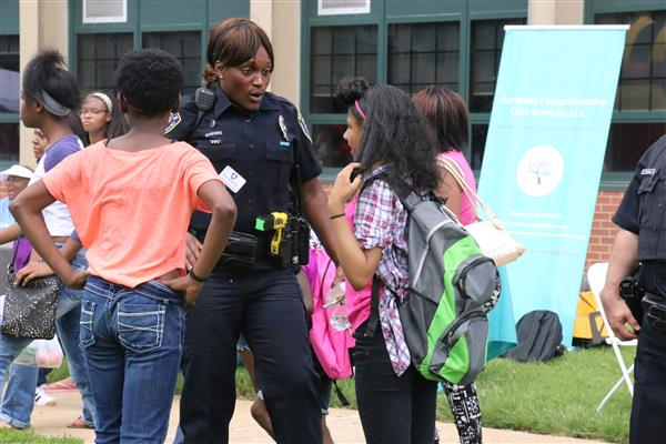 female police officer speaks with two young ladies