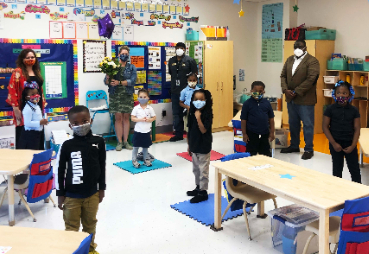 staff and students standing in ELC classroom